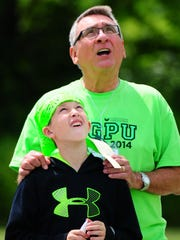 Robert Doneff and his grandson, Anton Doneff, watch rockets being launched Friday during the Grandparents University program at the University of Wisconsin-Green Bay.