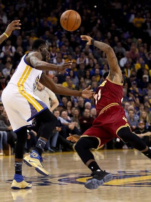 Draymond Green of the Golden State Warriors fouls LeBron James of the Cleveland Cavaliers at Oracle Arena on January 16, 2017 in Oakland, California.