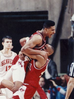 Paris McCurdy and Chandler Thompson celebrate upsetting Oregon State in the opening round of the 1990 NCAA Tournament on the way to the Sweet 16.