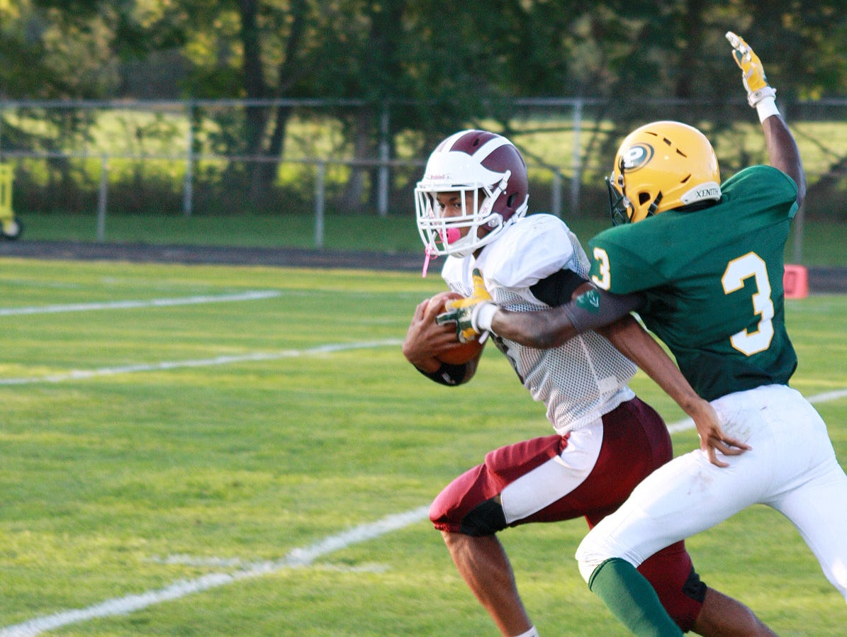Parchment's Darrion Turner is tackled by Pennfield's Parris Bolden on Thursday.
