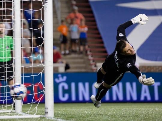 FC Cincinnati goalkeeper Spencer Richey (18) dives