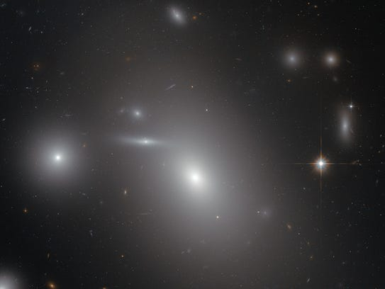 This image shows the elliptical galaxy NGC 4889 in