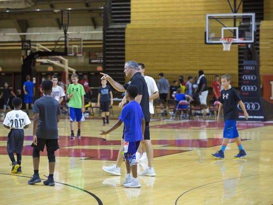 Rutgers men's basketball coach Steve Pikiell directs
