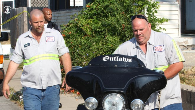 FBI agents across Indianapolis and Fort Wayne arrested dozens of members of the Outlaws Motorcycle Gang in a raid on July 11, 2012, on the gang's clubhouse at the corner of Jefferson and New York streets on Indianapolis' Eastside. Five motorcycles were removed by tow truck from the clubhouse.