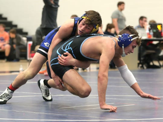 Ontario's Cody Mies has control of River Valley's Bogdan