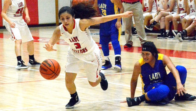 Loving junior point guard Cassandra Calderon gets a quick steal in the second quarter Tuesday.