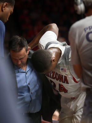 The Arizona Wildcats' Ray Smith says he is done playing  basketball.