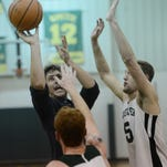 Broadwater alumnus Austin Riopel, left, puts up a heavily defended shot during the annual Broadwater Academy Alumni Basketball Game on Tuesday, Nov. 24, 2015. The alumni team won the game 61-53.