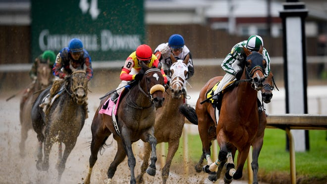 The field rounds corner four during race one on Derby Day at Churchill Downs in Louisville, Ky, Friday, May 5, 2016.  Bryan Woolston / Special to the Courier Journal
