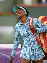 Venus Williams smiles as the crowd welcomes her at the Indian Wells Tennis Garden during the BNP Paribas Open, March 11, 2016.