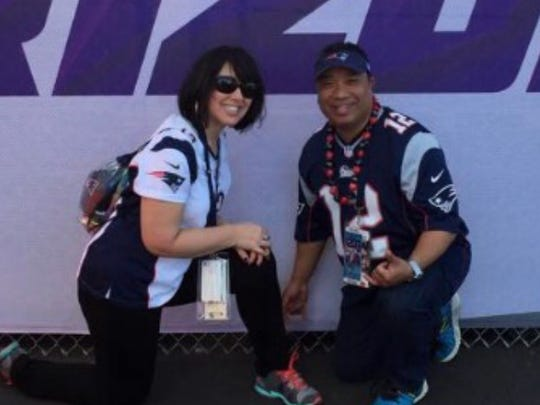 Webster High School graduate Melissa Cassarino, left, and her boyfriend, Carl Conui, pictured here in 2015 when they attended the Patriots win over the Seahawks in Glendale, Ariz.