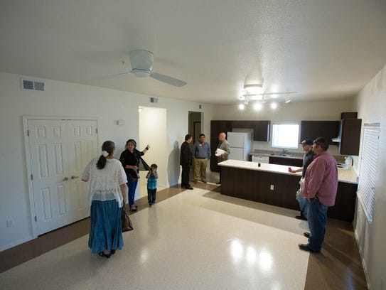 Local dignitaries tour the El Camino Real Apartments in Hatch, looking at one of the two-bedroom units. Thursday April 12, 2018. The apartments offer a housing option for farm labors in and around Hatch.