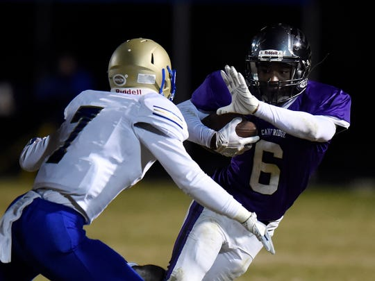 Cane Ridge wide receiver Jared Mccray (6) tries to elude Brentwood free safety Bryce Bergholtz (7) during the second half of an high school football game Friday, Nov. 10, 2017, in Antioch, Tenn. Cane Ridge won 28-13.