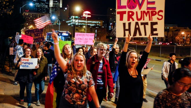 Hundreds march in an anti-Donald Trump protest around downtown Des Moines Thursday, Nov. 10, 2016.