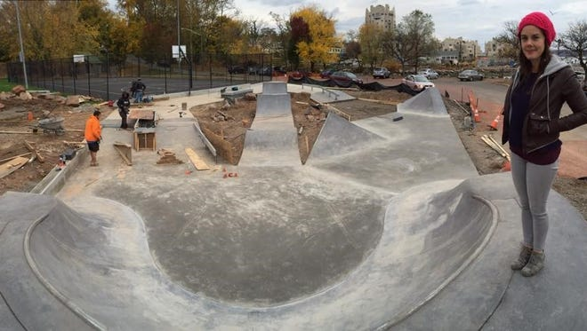 Sarah Anderson, who led the initiative to have it installed, stands atop the soon-to-open Nyack Skatepark.