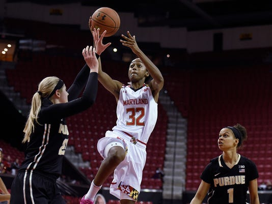 Maryland's Shatori Walker-Kimbrough, center, shoots between Purdue's  Bree Horocks, left, and Ashley Morrissette during the second half of an NCAA college basketball game Thursday, Feb. 11, 2016, in College Park, Md. Maryland won 73-59. (AP Photo/Gail Burton)