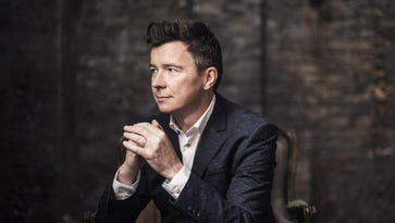 Singer Rick Astley rolls with the punches