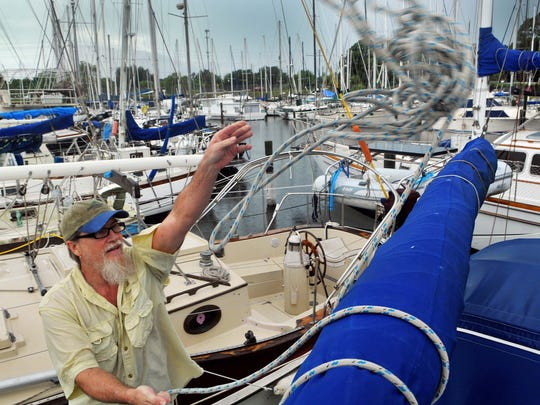 Oct 6, 2016; Brevard, FL, USA; J.C Martin who lives on his 41 foot sailboat on Merritt Island tries to secure the sails Thursday afternoon at the Harbor Squar marina in preparation for Hurricane Matthew to make landfall. Mandatory Credit: Craig Rubadoux/Florida Today via USA TODAY NETWORK
