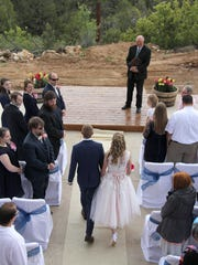A couple walks down the aisle during their small wedding