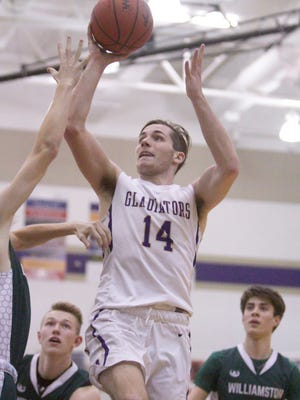 Geoffrey Knaggs had 21 points and 16 rebounds for Fowlerville in a victory over Hartland.