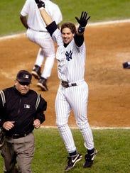 New York Yankees' Aaron Boone celebrates his solo home