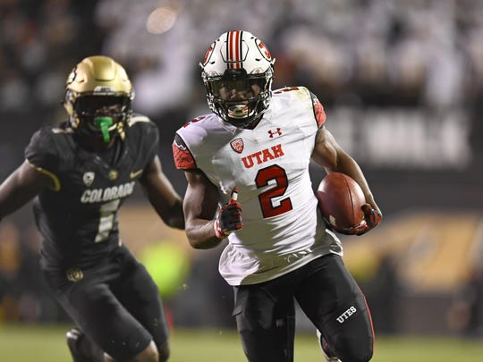 Utah running back Zack Moss carries the ball in the