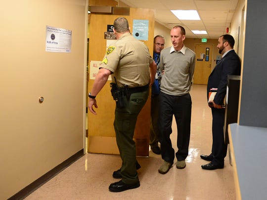 Emrance Berger is taken into custody at the Polk County Courthouse in Dallas on Monday, Nov. 10, 2014. Berger has been sentenced to 38 months in prison and five years of post-prison supervision.