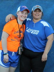 Seniors Jordan Modjeski (left) and Lize Kemp share a final moment at the Michael V. Polsinelli Athletic Complex following Ladywood's game against Mercy on Friday.