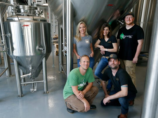 The Young Lion Brewing team: front left, head brewer Phil Platz and taproom manager David Diehl, and behind, co-owner Alicia Wolk, co-owner and CEO Jen Newman and assistant brewer Bill Miller.