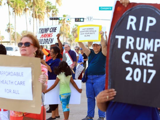 Protesters gather in front of Congressman Blake Farenthold's office as they support others in the Medicare For All March on Monday, July 24, 2017, in Corpus Christi.