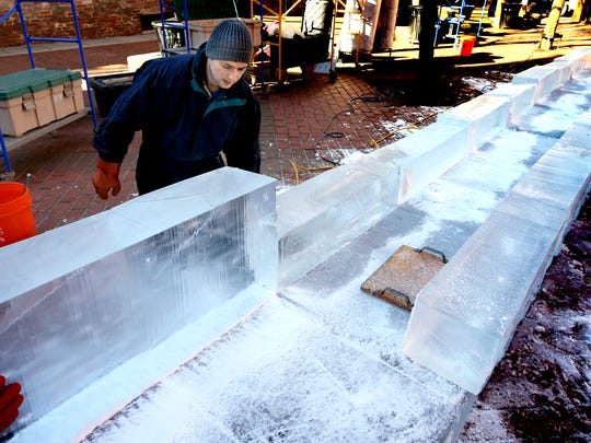 Joe DiMartino helps construct an ice slide in Cherry