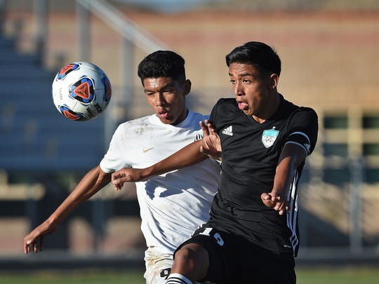 Galena's Jesus Medina, left, and North Valleys' Eduardo Martinez battle it out in Wednesday's semifinal match at North Valleys.