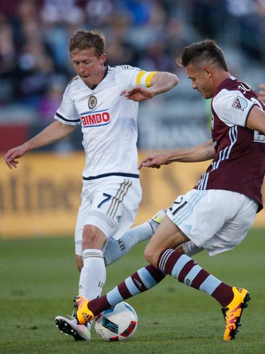 Philadelphia Union midfielder Brian Carroll, left, blocks a shot by Colorado Rapids forward Luis Solignac during the first half of an MLS soccer match Saturday, May 28, 2016, in Commerce City, Colo. (AP Photo/David Zalubowski)