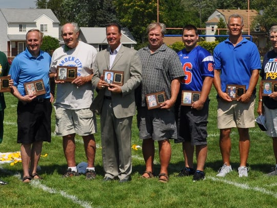 Pictured from left, the son of honoree Dana Ewles, Sylvia Wysocki, the ex-wife of honoree Pete Wysocki, Michael Pack, Keith Anleitner, Joe Pomykacz, Robert Kosowski, Ronald Wasczenski, Chris Wasczenski, Steve Freier, Roger Wilkes, Kevin Kramis and Dan York. Not pictured are Kris Brownlee, Gary Kaylen, Andrew Pack, Wade Payne, Kody Richardson, Michael Sparks and Andrew Burek.