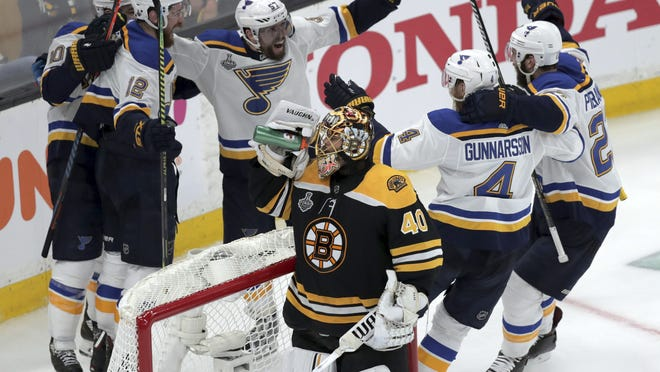 The St. Louis Blues' Zach Sanford (12) celebrates his goal with teammates behind Boston Bruins goaltender Tuukka Rask (40), during the third period of Game 7 of the Stanley Cup Final, Wednesday, June 12, 2019, in Boston. Exactly one year later, the Bruins' 4-1 loss to the Blues in Game 7 remains vivid.