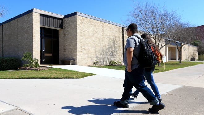Students pass by the Heldenfels Administration Building on Wednesday, Feb. 17, 2016, at Del Mar College in Corpus Christi.
