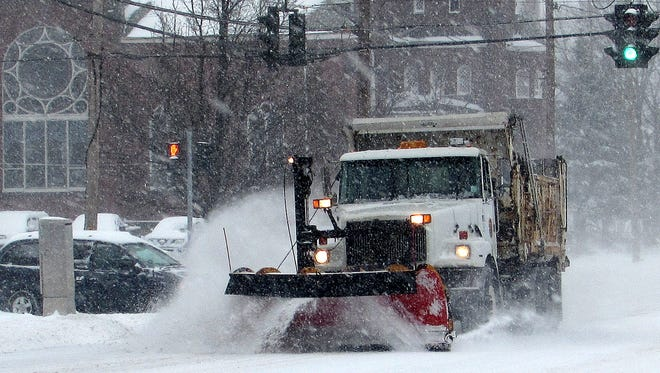 A plow clears snow from Madison Avenue in Elmira on  Tuesday morning.