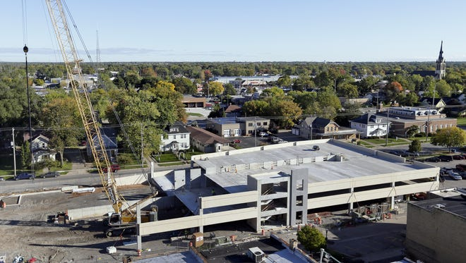 The construction of a parking ramp on Broad Street in Menasha displaced parking reserved for employees of McClone.