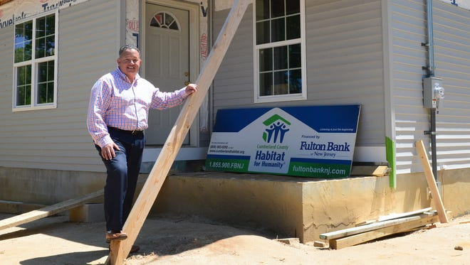 William Gonzalez, new executive director forthe Cumberland County Habitat for Humanity, visits a home under construction on Yelkca Street in Vineland.