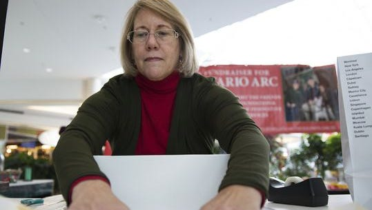 Molly Kommer wraps gifts for shoppers last month at Eastview Mall.