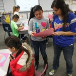 "Dixie Sun Elementary School teacher Karla Villalobos helps some of her students out with writing short essays in Spanish on ""What Friendship IsÉ"" during class time Friday, Jan. 30, 2015."