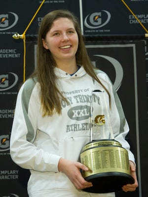 Mikaela Foecke holds the trophy during a press conference after being named the 2014-15 Gatorade National Volleyball Player of the Year, Tuesday, Dec. 16, 2014 in Fort Madison, Iowa. The award recognizes outstanding athletic excellence as well as high standards of academic achievement and exemplary character demonstrated on and off the field. Foecke was surprised with the news by silver medalist April Ross, who earned Gatorade National Volleyball Player of the Year honors in 1999-00. Photo/Gatorade, Susan Goldman, handout.