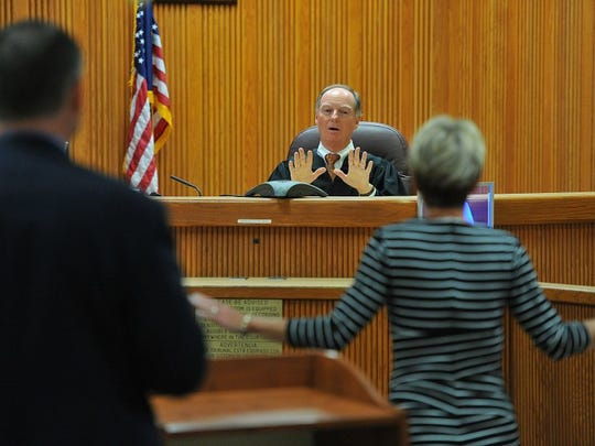 Circuit Judge Robert Makemson (center) reacts to comments from Chief Assistant State Attorney Tom Bakkedahl (left) and Public Defender Diamond Litty after rejecting Litty's call for removing the possible penalty of life imprisonment without parole for Tyler Hadley during the seventh day of Hadley's sentencing hearing March 18, 2014, at the St. Lucie County Courthouse in Fort Pierce. (FILE PHOTO)