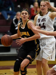 Algoma's Anna Dier (44) drives to the basket against