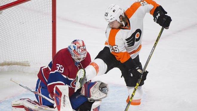 The Flyers' Ryan White (25) looks for a deflection on Montreal Canadiens goaltender Mike Condon during the second period Friday in Montreal.