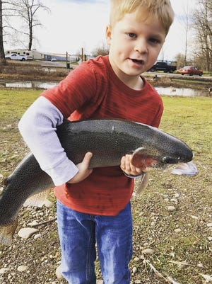 Konner Matthey, 5, hangs on tight to a massive hatchery brood rainbow, his first-ever trout, at Walter Wirth Lake. He caught the behemoth during the Martin Luther King Jr. holiday fishing with dad, Mark, and brother, Karson, 8.