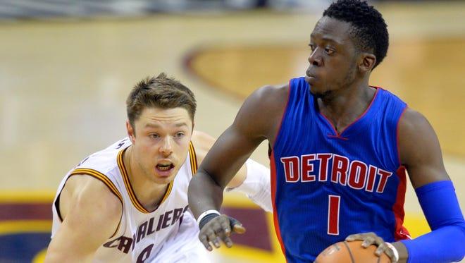 Detroit Pistons guard Reggie Jackson (1) dribbles against Cleveland Cavaliers guard Matthew Dellavedova (8) in the fourth quarter at Quicken Loans Arena.