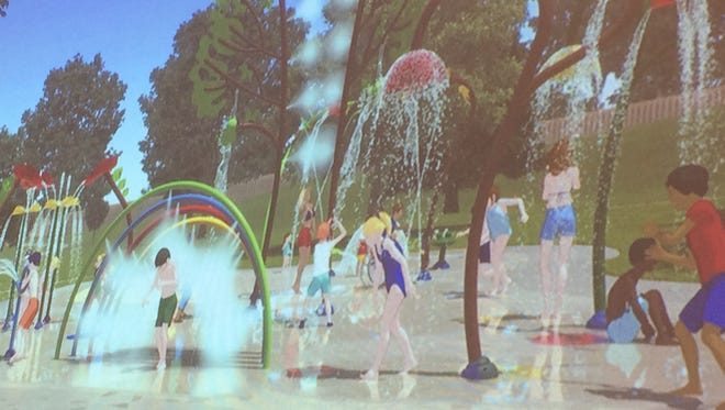 A splash pad rendering shows possible features, including flowers and trees