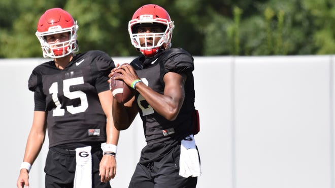 Georgia quarterbacks D'Wan Mathis (2) and Carson Beck (15) during the Bulldogs' practice in Athens on Thursday.