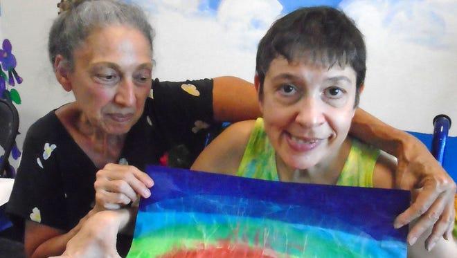 Kelly, at right, and sister Linda Cappellano
